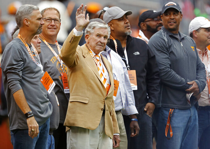 FILE - In this Oct. 12, 2019, file photo, former Tennessee head football coach Johnny Majors waves to fans as he and members of the 1998 football team are introduced in the first half of an NCAA college football game against Mississippi State, in Knoxville, Tenn. Majors, the coach of Pittsburgh's 1976 national championship team and a former coach and star player at Tennessee, has died. He was 85. Majors died Wednesday morning, June 3, 2020, at home in Knoxville, Tenn., according to a statement from his wife, Mary Lynn Majors. (AP Photo/Wade Payne, FIle)
