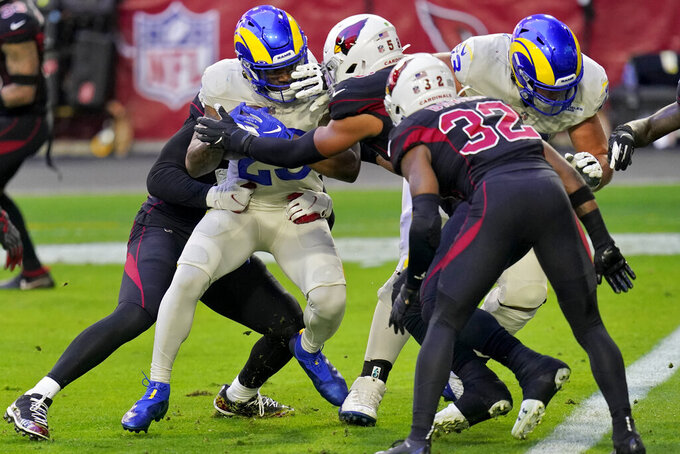 Los Angeles Rams running back Cam Akers, left, scores a touchdown as Arizona Cardinals middle linebacker Jordan Hicks (58) defends during the first half of an NFL football game, Sunday, Dec. 6, 2020, in Glendale, Ariz. (AP Photo/Ross D. Franklin)