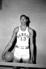 FILE - This is a March 1, 1957, file photo showing Kansas college basketball player Wilt Chamberlain posed in Allen Field House in Lawrence, Kan. UNC sure made things interesting to win its first NCAA title. After a triple-overtime win against Michigan State in the semifinals, the unbeaten and top-ranked Tar Heels played three more overtimes in a 54-53 win against Wilt Chamberlain and Kansas in the NCAA championship game in the Jayhawks' backyard of Kansas City, Missouri. (AP Photo/File)