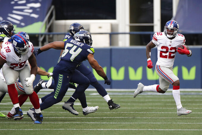 New York Giants running back Wayne Gallman (22) breaks away for a 60-yard run against the Seattle Seahawks during the second half of an NFL football game, Sunday, Dec. 6, 2020, in Seattle. (AP Photo/Larry Maurer)