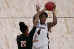 South Carolina forward Aliyah Boston (4) looks to pass under pressure from Mercer guard Shannon Titus (21) during the second half of a college basketball game in the first round of the women's NCAA tournament at the Alamodome in San Antonio, Sunday, March 21, 2021. (AP Photo/Charlie Riedel)