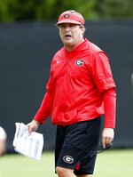 Georgia head coach Kirby Smart watches drill during their NCAA college football training camp practice Friday, Aug. 3, 2018 in Athens, Ga. (AP Photo/John Bazemore)