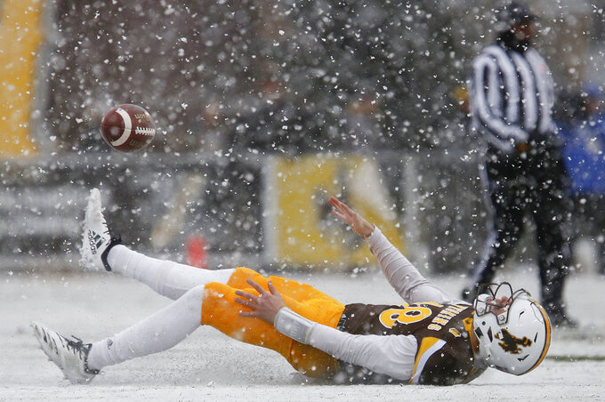 Wyoming quarterback Tyler Vander Waal (18) slides across the field after missing a pass against Air Force during an NCAA college football game at War Memorial Stadium Saturday, Nov. 17, 2018, in Laramie, Wyo. (Josh Galemore/The Casper Star-Tribune via AP)
