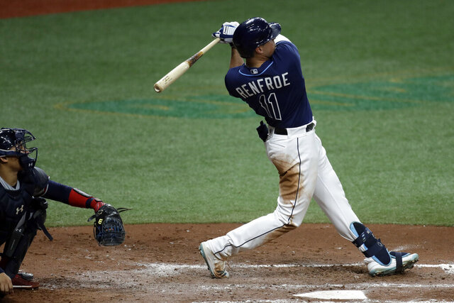 Tampa Bay Rays' Hunter Renfroe connects for a three-run home run off Atlanta Braves starting pitcher Mike Foltynewicz during the fourth inning of a baseball game Monday, July 27, 2020, in St. Petersburg, Fla. (AP Photo/Chris O'Meara)