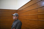 A member of security forces stands guard inside a court room before the start of a final trial session for suspects charged in connection with killing of two Scandinavian tourists in Morocco's Atlas Mountains, in Sale, near Rabat, Morocco, Thursday, July 18, 2019. The three main defendants in the brutal slaying of two female Scandinavian hikers have asked for forgiveness from Allah ahead of a verdict. (AP Photo/Mosa'ab Elshamy)