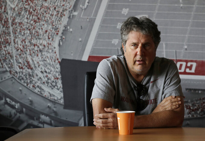 Washington State head coach Mike Leach listens to a question during an interview before NCAA college football practice, Thursday, Aug. 16, 2018, in Pullman, Wash. WSU finished 9-4 last season, winning all seven of their home games, but they stumbled in their final two games, losing to cross-state rival Washington and getting beat by Michigan State in the Holiday Bowl. (AP Photo/Ted S. Warren)