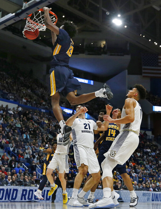 Murray State's Devin Gilmore (13) dunks against Marquette players during the first half of a first round men's college basketball game in the NCAA Tournament, Thursday, March 21, 2019, in Hartford, Conn. (AP Photo/Elise Amendola)