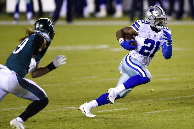 Dallas Cowboys' Ezekiel Elliott rushes during the first half of an NFL football game against the Philadelphia Eagles, Sunday, Nov. 1, 2020, in Philadelphia. (AP Photo/Derik Hamilton)