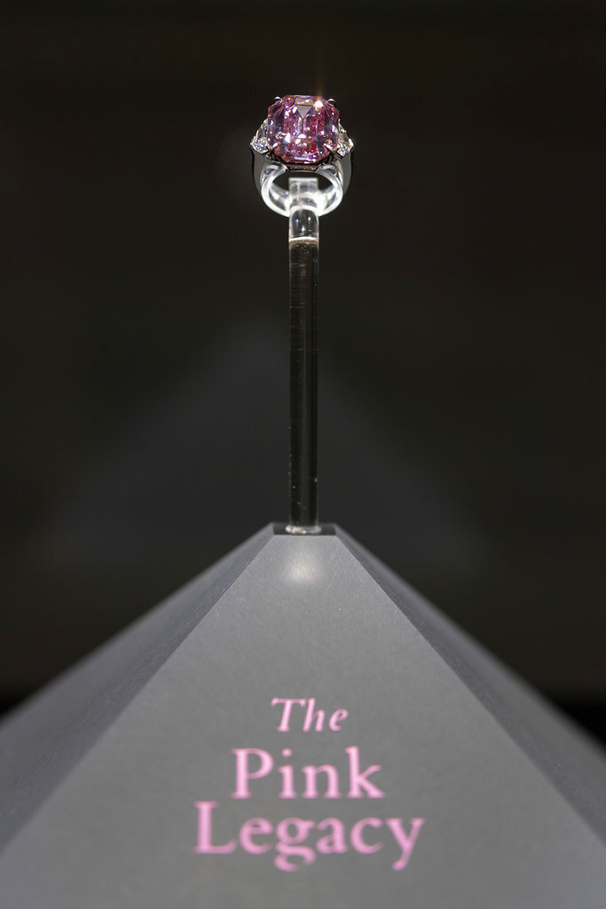 An 18.96-carat fancy vivid pink diamond is shown on display during a preview at Christie's in Geneva, Switzerland, Thursday, Nov. 8, 2018. It is estimated to sell between $30-$50 million. The auction will take place in Geneva, on Nov. 13. (Martial Trezzini/Keystone via AP)