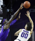 TCU forward JD Miller (15) blocks a shot by Kansas State guard Mike McGuirl (00) during the first half of an NCAA college basketball game in Manhattan, Kan., Saturday, Jan. 19, 2019. (AP Photo/Orlin Wagner)