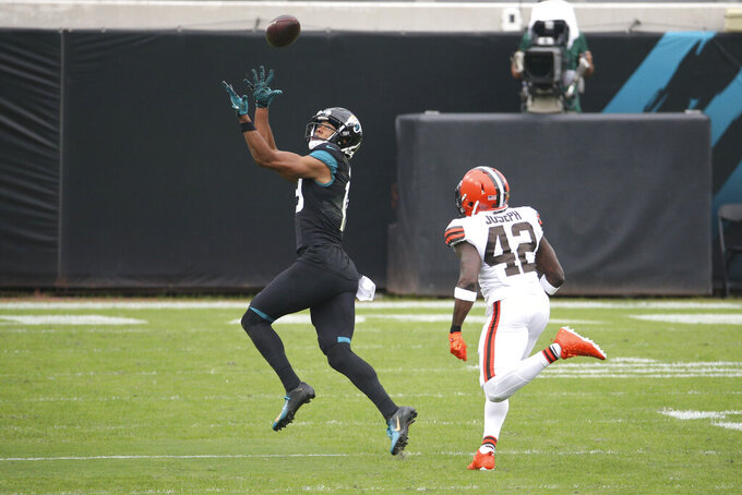 Jacksonville Jaguars wide receiver Collin Johnson, left, makes a reception in front of Cleveland Browns safety Karl Joseph (42) for a touchdown during the first half of an NFL football game, Sunday, Nov. 29, 2020, in Jacksonville, Fla. (AP Photo/Stephen B. Morton)