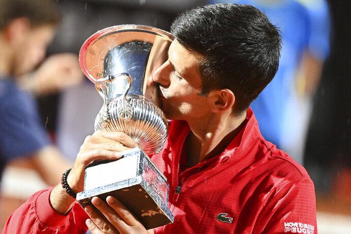 Serbia's Novak Đjoković kisses his trophy after winning his match with Argentina's Diego Sebastián Schwartzman during their final match at the Italian Open tennis tournament, in Rome, Monday, Sept. 21, 2020. (Alfredo Falcone/LaPresse via AP)