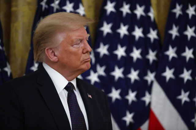 President Donald Trump listens during an event about the PREVENTS