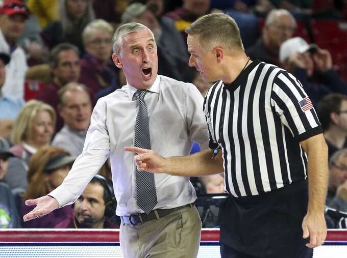 Arizona State coach Bobby Hurley, left, argues a call with an official during the first half of the team's NCAA college basketball game against Princeton, Saturday, Dec. 29, 2018, in Tempe, Ariz. Princeton defeated No. 17 Arizona State 67-66. (AP Photo/Ralph Freso)