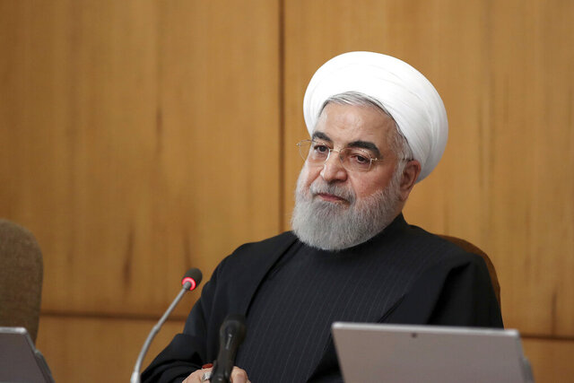 In this photo released by the official website of the Office of the Iranian Presidency, President Hassan Rouhani speaks in a cabinet meeting in Tehran, Iran, Wednesday, Jan. 15, 2020. Iran's president is warning that European soldiers deployed in the Mideast
