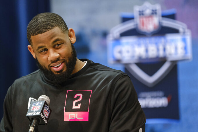 FILE - In this Feb. 27, 2020, file photo, TCU's Ross Blacklock speaks during a news conference at the NFL football scouting combine in Indianapolis. The division that led the AFC in sacks in 2019 might be even tougher to block next season. Every team in the AFC South made at least one major move along the defensive front between free agency and the draft. Houston used its first two picks to land Blacklock and Florida pass-rusher Jon Greenard. (AP Photo/AJ Mast, File)