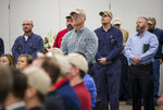 People listen during an announcement about a building expansion at Toyota Motor Manufacturing, Thursday, March 14, 2019, in Buffalo, W.Va. Toyota Motor Corp. on Thursday announced it is investing an additional $750 million at five U.S. plants. (Sholten Singer/The Herald-Dispatch via AP)