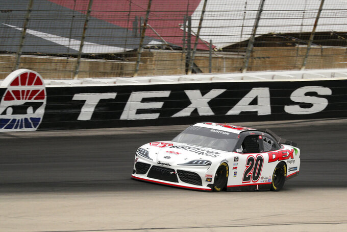 Harrison Burton (20) comes down the front stretch during a NASCAR Xfinity Series auto race at Texas Motor Speedway in Fort Worth, Texas, Saturday, Oct. 24, 2020. (AP Photo/Richard W. Rodriguez)