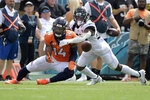 Denver Broncos wide receiver Courtland Sutton (14) catches a pass despite defensive effort by Jacksonville Jaguars cornerback Chris Claybrooks, right, during the first half of an NFL football game, Sunday, Sept. 19, 2021, in Jacksonville, Fla. (AP Photo/Phelan M. Ebenhack)