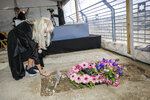 Miriam Adelson, mourns next to the grave of her husband, Sheldon Adelson, in Jerusalem, during his funeral, Friday, Jan. 15, 2021. (Oren Ben Hakoon/Israel Hayom/ Pool Photo via AP)