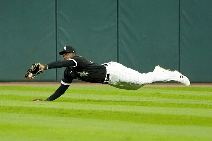 Chicago White Sox's Luis Robert dives and catches a fly ball from Pittsburgh Pirates' Jacob Stallings during the eighth inning of a baseball game Tuesday, Aug. 31, 2021, in Chicago. (AP Photo/Charles Rex Arbogast)