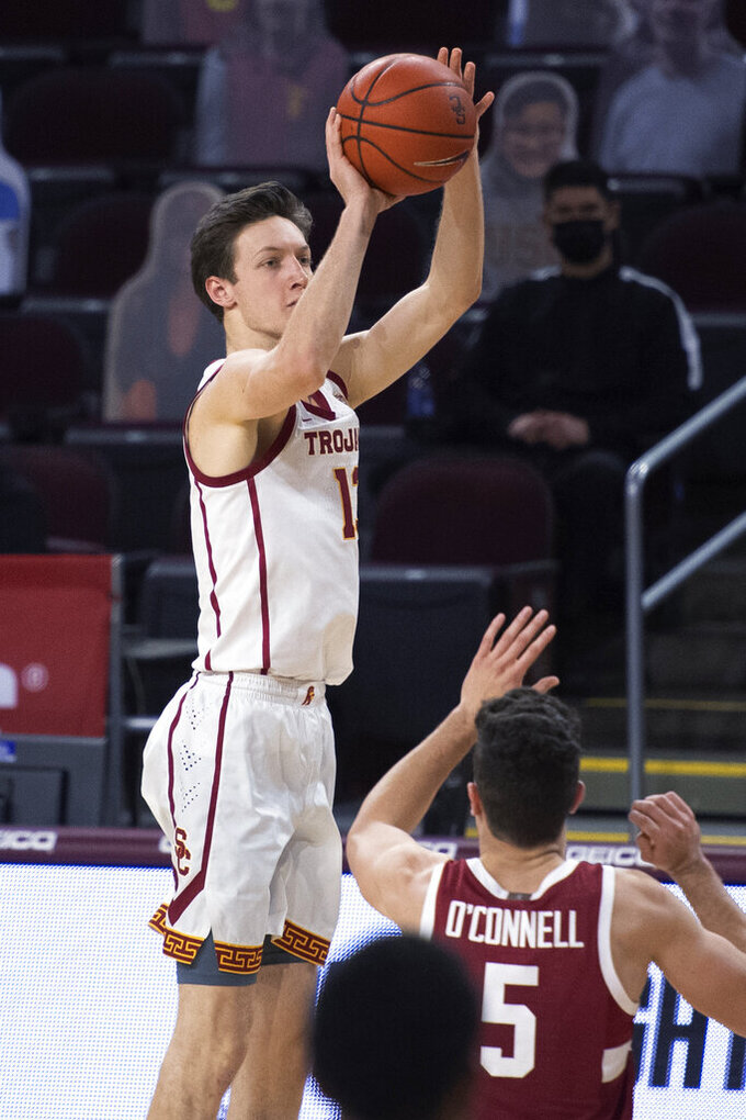 Southern California guard Drew Peterson shoots a 3-pointer over Stanford guard Michael O'Connell during the second half of an NCAA college basketball game Wednesday, March 3, 2021, in Los Angeles. (AP Photo/Kyusung Gong)