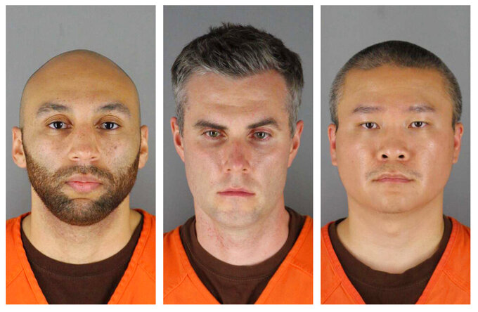 FILE - This combination of photos provided by the Hennepin County Sheriff's Office in Minnesota on Wednesday, June 3, 2020, shows from left, former Minneapolis police Officers J. Alexander Kueng, Thomas Lane and Tou Thao. A more detailed trial schedule for three former Minneapolis police officers charged with aiding and abetting in the death of George Floyd has been set for next March, according to an order made public Wednesday, June 9, 2021. Last month, a judge pushed the trial of Lane, Kueng and Thao out to next March, in part because he wanted publicity from the trial of ex-officer Derek Chauvin to cool down, and partly to allow a federal case against the officers to go forward first. (Hennepin County Sheriff's Office via AP File)