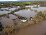 Flood water surrounds Upton upon Severn, England, Tuesday Feb. 18, 2020. Britain's Environment Agency issued severe flood warnings Monday, advising of life-threatening danger after Storm Dennis dumped weeks' worth of rain in some places. (Steve Parsons/PA via AP)