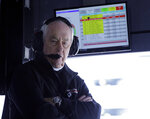 FILE - In this Jan. 26, 2019, file photo, Penske Acura team owner Roger Penske monitors his Acura DPi cars on the track from his pit stall at the IMSA 24-hour race at Daytona International Speedway in Daytona Beach, Fla. Penske's drivers swept all the races at Indianapolis Motor Speedway and his reward has been induction into the NASCAR Hall of Fame. Penske will be honored Friday night along with Jeff Gordon, deceased drivers Davey Allison and Alan Kulwicki and fellow team owner Jack Roush. (AP Photo/Terry Renna, File)