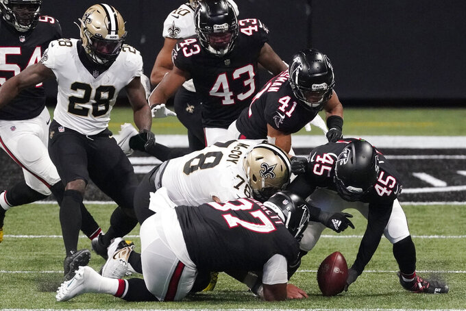 Atlanta Falcons linebacker Deion Jones (45) recovers a New Orleans Saints fumble during the second half of an NFL football game, Sunday, Dec. 6, 2020, in Atlanta. (AP Photo/John Bazemore)