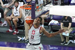 Stanford forward Oscar da Silva dunks against Washington during the second half of an NCAA college basketball game, Thursday, Feb. 18, 2021, in Seattle. (AP Photo/Ted S. Warren)