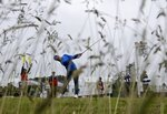 Shubhankar Sharma, of India, hits off the ninth tee during a practice round for the U.S. Open Golf Championship, Wednesday, June 13, 2018, in Southampton, N.Y. (AP Photo/Julio Cortez)