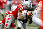 Ohio State linebacker Pete Werner, left, tackles Maryland running back Anthony McFarland during the first half of an NCAA college football game, Saturday, Nov. 9, 2019, in Columbus, Ohio. (AP Photo/Jay LaPrete)