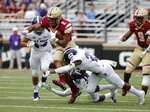 Boston College running back AJ Dillon (2) rushes through the defensive pressure of Holy Cross linebacker Ryan Brady (44) and defensive back John Smith (27) during the first half of a college football game, Saturday, Sept. 8, 2018, in Boston. (AP Photo/Mary Schwalm)