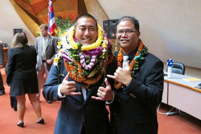 FILE - In this May 5, 2016 file photo, former Hawaii Rep. Derek Kawakami, left, and Rep. James Tokioka, right, both of Kauai, pose for photos in Honolulu. Kawakami has a choice word for a Florida man accused of trying to flout Hawaii's traveler quarantine: