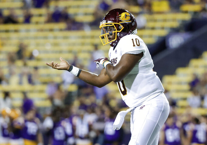 Central Michigan quarterback Daniel Richardson (10) reacts after throwing a touchdown pass against LSU during the fourth quarter of an NCAA college football game in Baton Rouge, La,. Saturday, Sept. 18, 2021. (AP Photo/Derick Hingle)