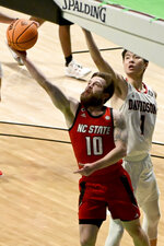 North Carolina State guard Braxton Beverly (10) drives to the basket past Davidson forward Hyunjung Lee (1) in the first half of an NCAA college basketball game in the first round of the NIT, Thursday, March 18, 2021, in Denton, Texas. (AP Photo/Matt Strasen)
