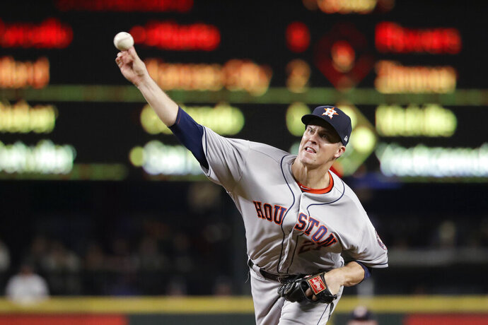 Houston Astros starting pitcher Zack Greinke throws to a Seattle Mariners batter during the fifth inning of a baseball game Wednesday, Sept. 25, 2019, in Seattle. (AP Photo/Elaine Thompson)