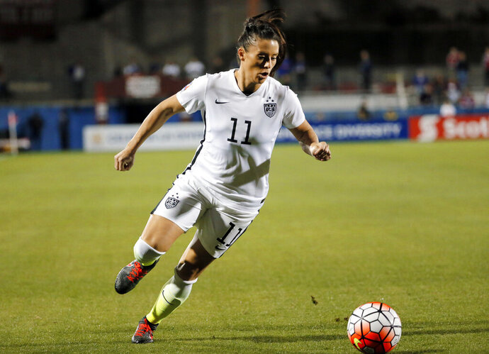 FILE - In this Feb. 10, 2016, file photo, United States defender Ali Krieger (11) controls the ball during a CONCACAF Olympic qualifying tournament soccer match against Costa Rica in Frisco, Texas. Krieger was named to the U.S. women's national team roster Thursday, March 21, 2019, for exhibition matches against Australia and Belgium as the team prepares for the World Cup in France starting in June. (AP Photo/Tony Gutierrez, File)