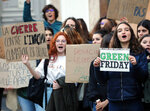 Young people protests against Black Friday, Nov 29, 2019, in Bayonne, southwestern France. Placard at left reads