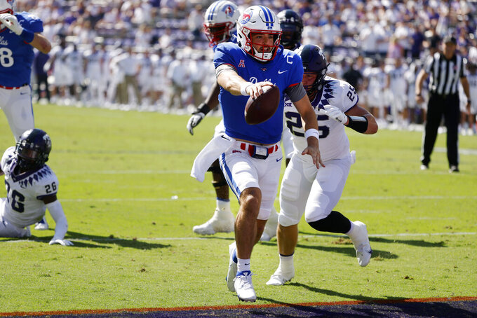 SMU quarterback Tanner Mordecai (8) scores a touchdown in front of TCU linebacker Wyatt Harris (25) during the first half of an NCAA football game in Fort Worth, Texas, Saturday, Sept. 25, 2021. (AP Photo/Michael Ainsworth)