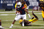 Arizona running back Gary Brightwell (0) runs the ball against Arizona State in the first half of an NCAA college football game, Friday, Dec. 11, 2020, in Tucson, Ariz. (AP Photo/Rick Scuteri)
