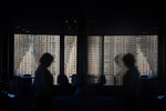 A tall apartment building is seen through the window of the Seaside Top observatory located on the 40th floor of the World Trade Center, Wednesday, Sept. 25, 2019, in Tokyo. (AP Photo/Jae C. Hong)