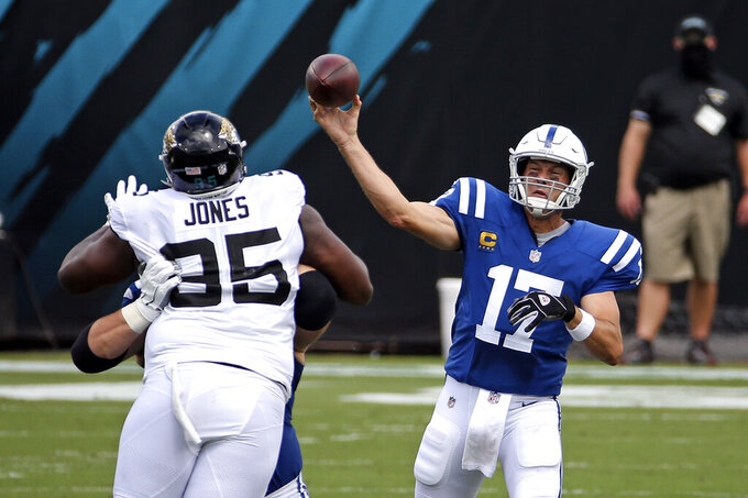 Indianapolis Colts quarterback Philip Rivers (17) throws a pass over Jacksonville Jaguars defensive tackle Abry Jones (95) during the first half of an NFL football game, Sunday, Sept. 13, 2020, in Jacksonville, Fla. (AP Photo/Stephen B. Morton)