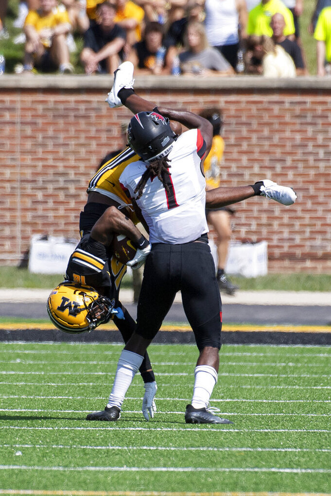 Missouri wide receiver Chance Luper, left, is tackled by Southeast Missouri State defensive back Lawrence Johnson during the second quarter of an NCAA college football game Saturday, Sept. 18, 2021, in Columbia, Mo. (AP Photo/L.G. Patterson)