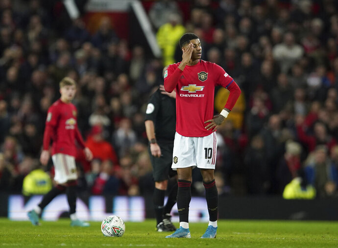Manchester United's Marcus Rashford waits to restart after Manchester City scored their third goal of the game during the English League Cup semifinal first leg soccer match between Manchester United and Manchester City and at Old Trafford, Manchester, England, Tuesday, Jan. 7, 2020. (AP Photo/Jon Super)