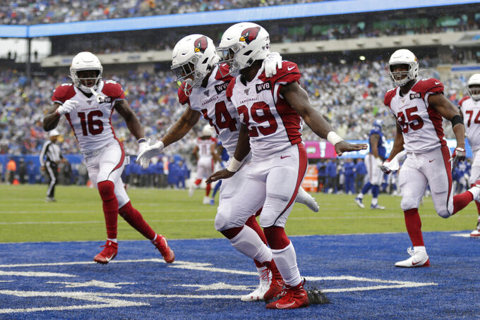 Arizona Cardinals' Chase Edmonds (29), center, celebrates with teammates after scoring during the first half of an NFL football game against the New York Giants, Sunday, Oct. 20, 2019, in East Rutherford, N.J. (AP Photo/Adam Hunger)