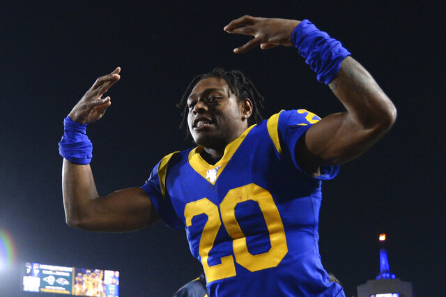 FILE - Los Angeles Rams cornerback Jalen Ramsey celebrates the team's win over the Chicago Bears in an NFL football game Sunday, Nov. 17, 2019 in Los Angeles. Jalen Ramsey will become the highest-paid defensive back in NFL history after agreeing to a five-year, $105 million contract extension with the Rams. The extension announced Wednesday, Sept. 9, 2020, includes $71.2 million, the most guaranteed money ever given to a defensive back, according to Ramsey's agent, David Mulugheta.(AP Photo/Kyusung Gong, File)