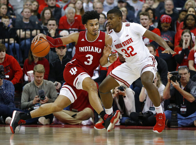 Indiana's Justin Smith, left, posts up against Ohio State's E.J. Liddell during the second half of an NCAA college basketball game Saturday, Feb. 1, 2020, in Columbus, Ohio. Ohio State beat Indiana 68-59. (AP Photo/Jay LaPrete)