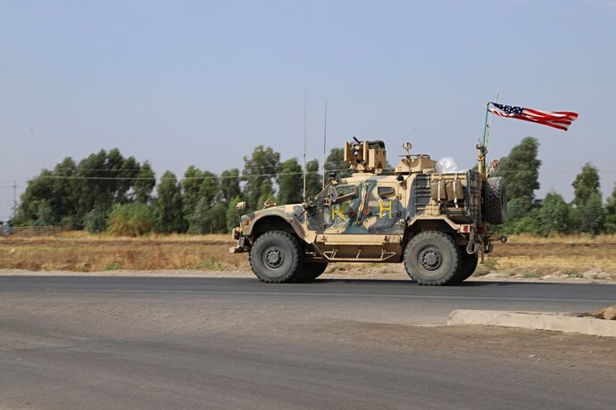A U.S. military vehicle, part of a convoy, arrives near Dahuk, Iraqi, Monday, Oct. 21, 2019. Defense Secretary Mark Esper said Monday that under the current plan all U.S. troops leaving Syria will go to western Iraq and the military will continue to conduct operations against the Islamic State group to prevent its resurgence. (AP Photo)